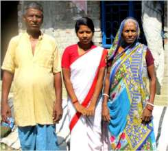 Sandipta with her Grandparents before their house