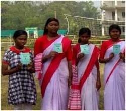 Srabana* (2nd from left) with library card