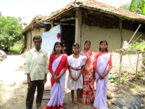 Sujata with other family members in front of house