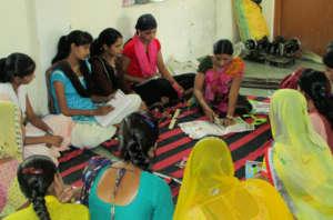 Girls learning to make Designer Bags