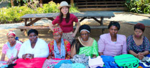 microfinance ladies showing off their products