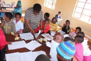 NCP teacher distributing worksheets