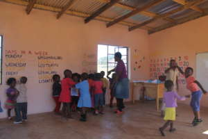 Teacher Mbali dancing with the children