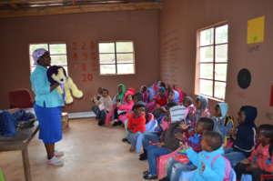 Teacher Mgazi with Frank the lion
