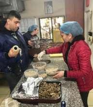 Staff preparing meals
