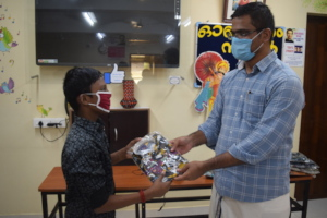 Our director distributing new clothes for children