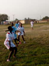 Bedaabour teen girls playing soccer.