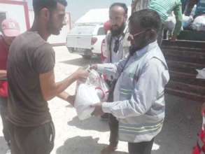 Ration Packet Handed Over to the Refugee