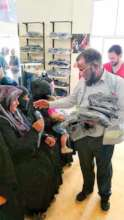 Warm Clothes being Distributed among Refugees