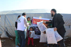 Relief goods being distributed among Syrian Refuge