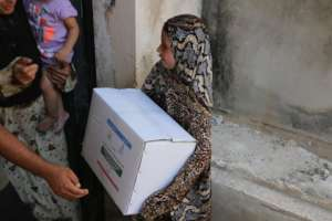 Small Girl receiving Packet of Relief Goods