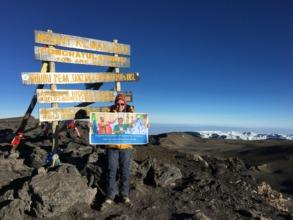 Sara Safari at the summit of Mt. Kilimanjaro