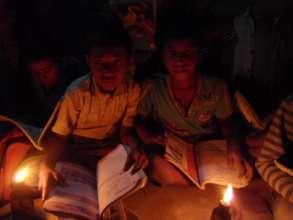Studying with Kerosene Lamps