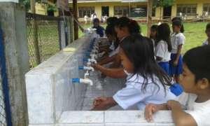 Washing hands before lunch at Kasambuhan ES