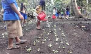 watering school garden At Bunot Elementary