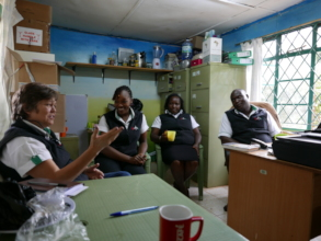 Kamili team meeting at the Lower Kabete clinic