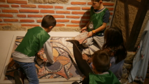 Kids from Vratsa arranging part of a Roman mosaic