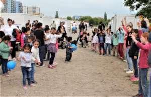 ARCHE-kids bringing colour into a refugee shelter.