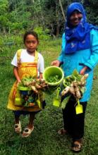 Gardener wearing rice sack apron with Principal