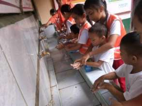 Students wash hands before school lunch