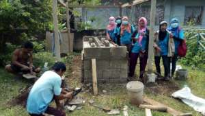 Teachers inspect PTA parent carpenter