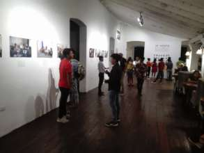 Enjoying the photo-exhibition with the students