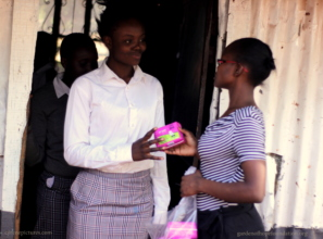 A happy girl receiving sanitary towels .