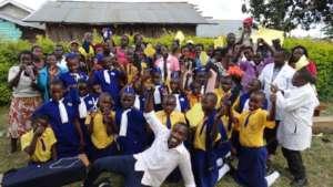 Our health coordinator Patrick Tusiime & students