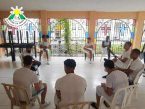 Teacher Adarley teaching English in a youth prison