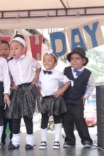 Kindergarten students dancing to the rhythm