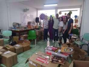 Volunteers help categorize 5000 library  books