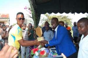 Young Pangani leader receiving leadership award