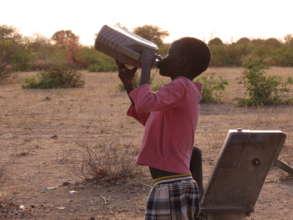 Boy Drinking Water in South Sudan