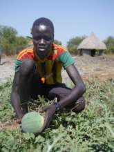 Jal shows off one of his watermelons