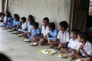 Children in school eating meal