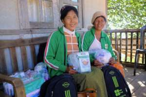 Local trainers receiving materials for outreach