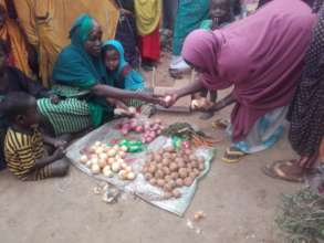 Uba and her children sell vegetables.