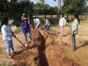 Community Residents Installing Water System