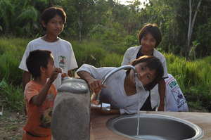 Children drinking clean H2O at the schoolhouse.