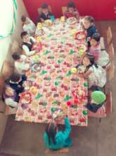 A group of children having their lunch