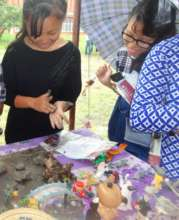 Girls explore clay and sand therapy at youth fair