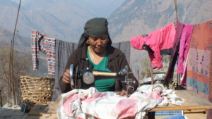 A woman receiving training in her village