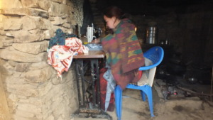 Ms. Bebo working at her own little shop in village