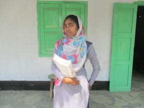Rahima Standing at school varanda