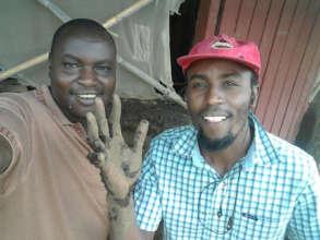 Chege and John at mud work