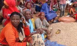 Community women at grain distribution