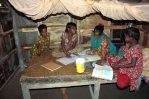Students are studying with the help of Solar Lamp