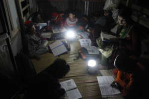 Students are reading by supported solar lamps