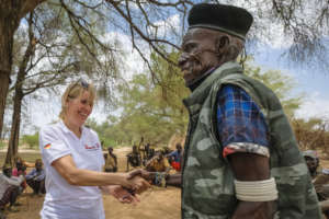Our employee greeted by the chief of Nanam village