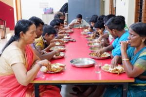 Staff & chidlren eating
